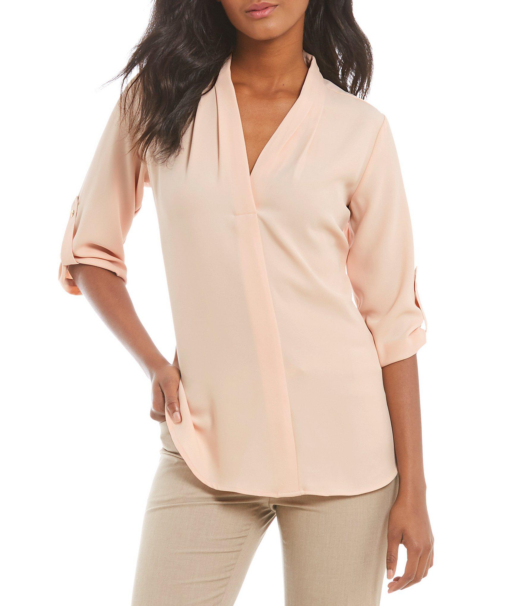 9abe64e083ee Lyst - Calvin Klein Pleated V-neck Roll-tab Long Sleeve Top in Black