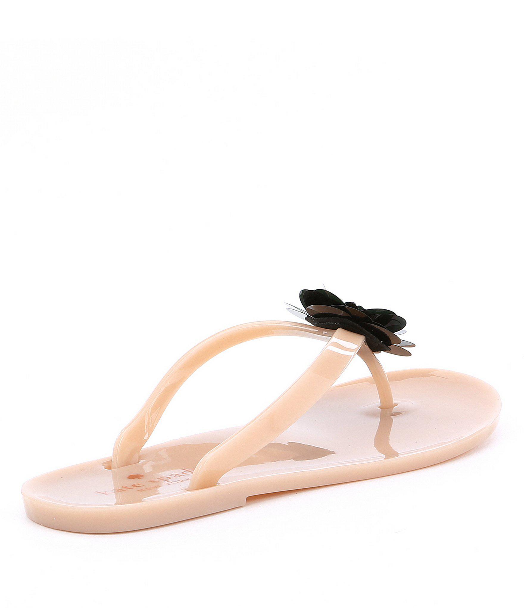 2e7597dbfe74 Lyst - Kate Spade Fiorina Flower Jelly Flip Flops in Pink