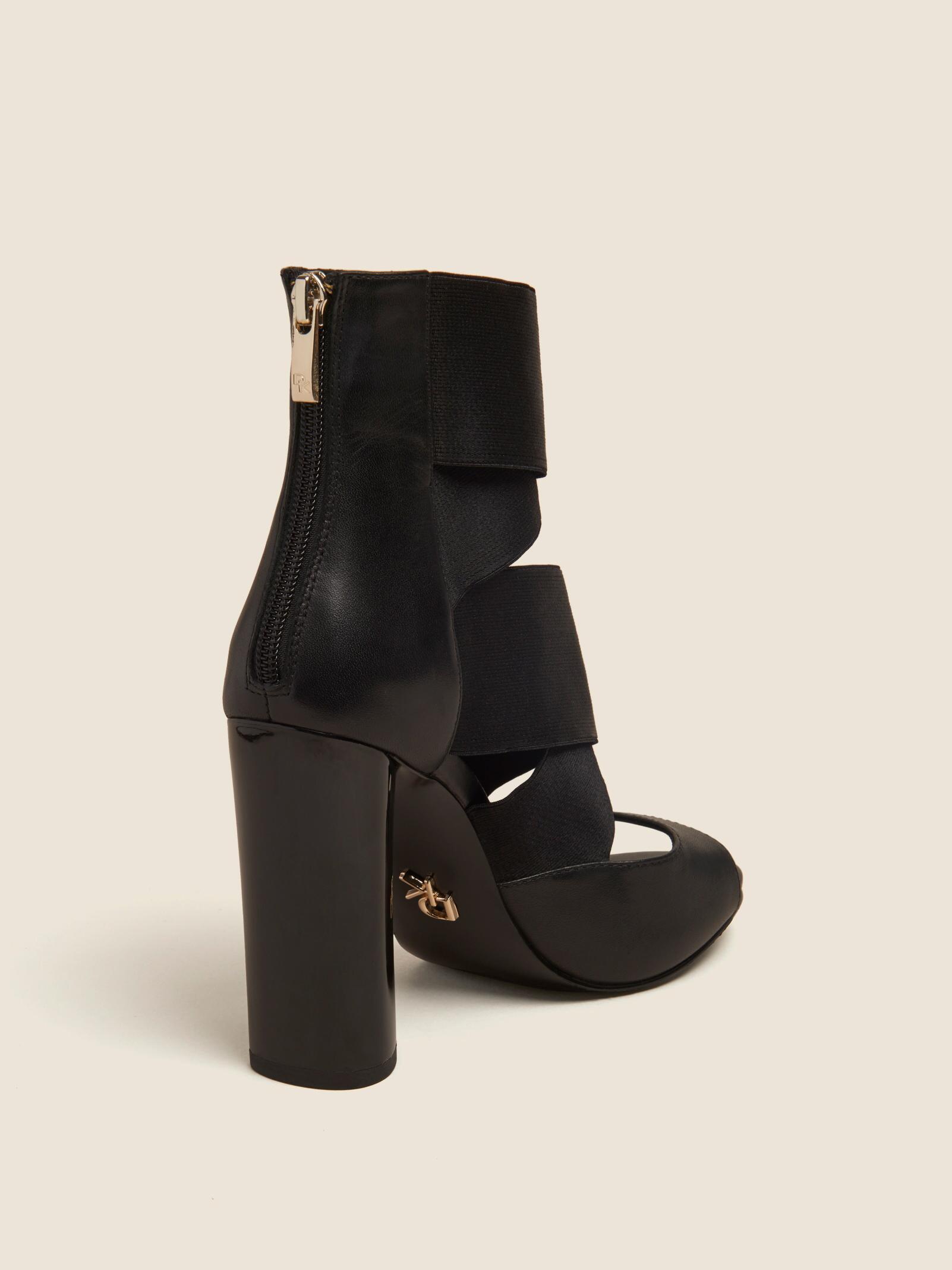 ac1fec87ab5 Lyst - DKNY Briana Multi-strap Heeled Leather Sandal in Black