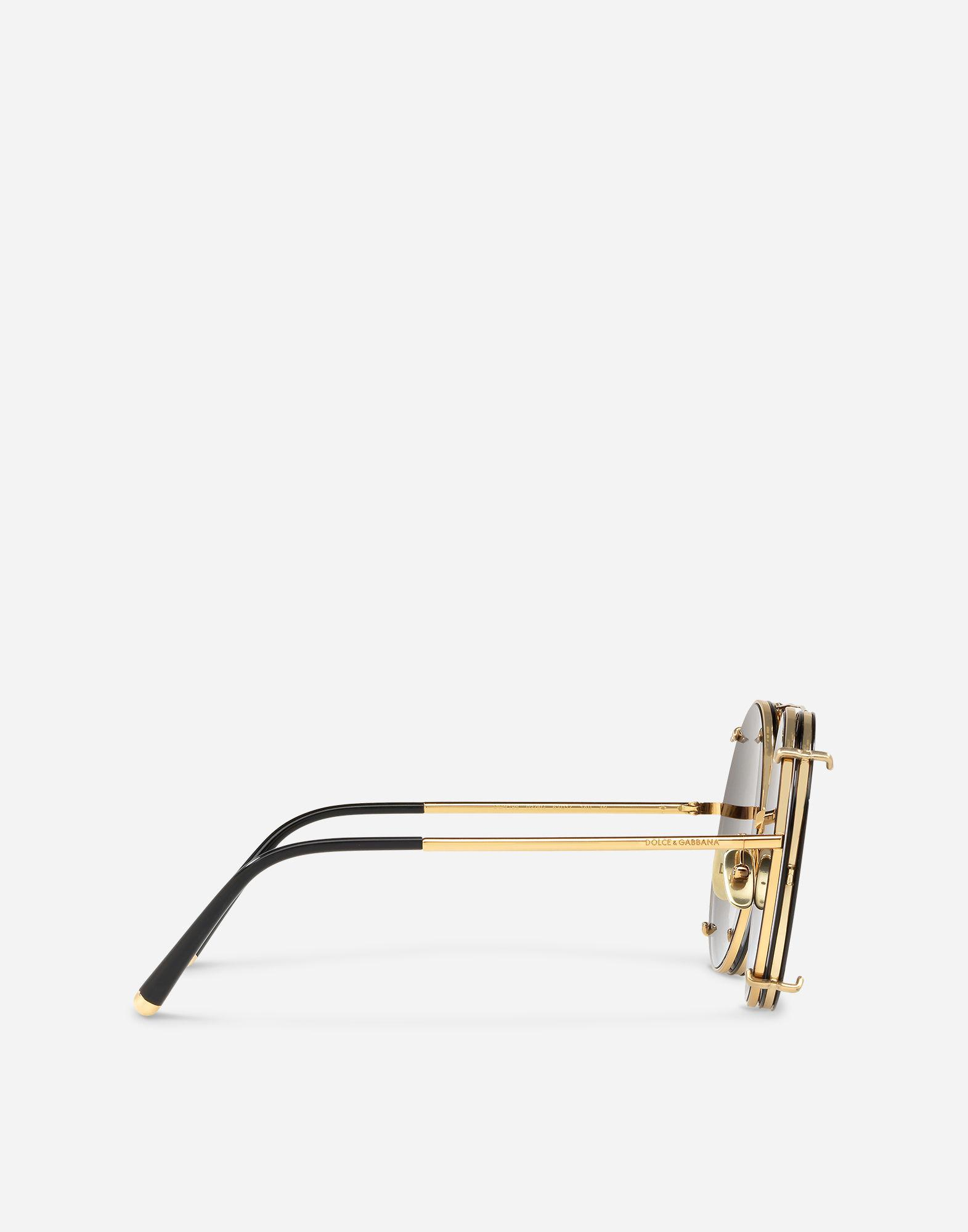c4e398b77b1 Lyst - Dolce   Gabbana Round Clip-on Sunglasses In Gold Metal With ...