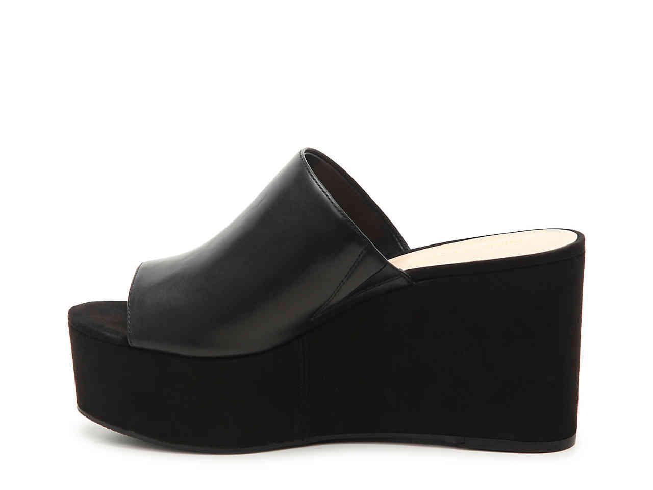 fbebd2a5f550 Lyst - Nine West Kelsawn Wedge Sandal in Black