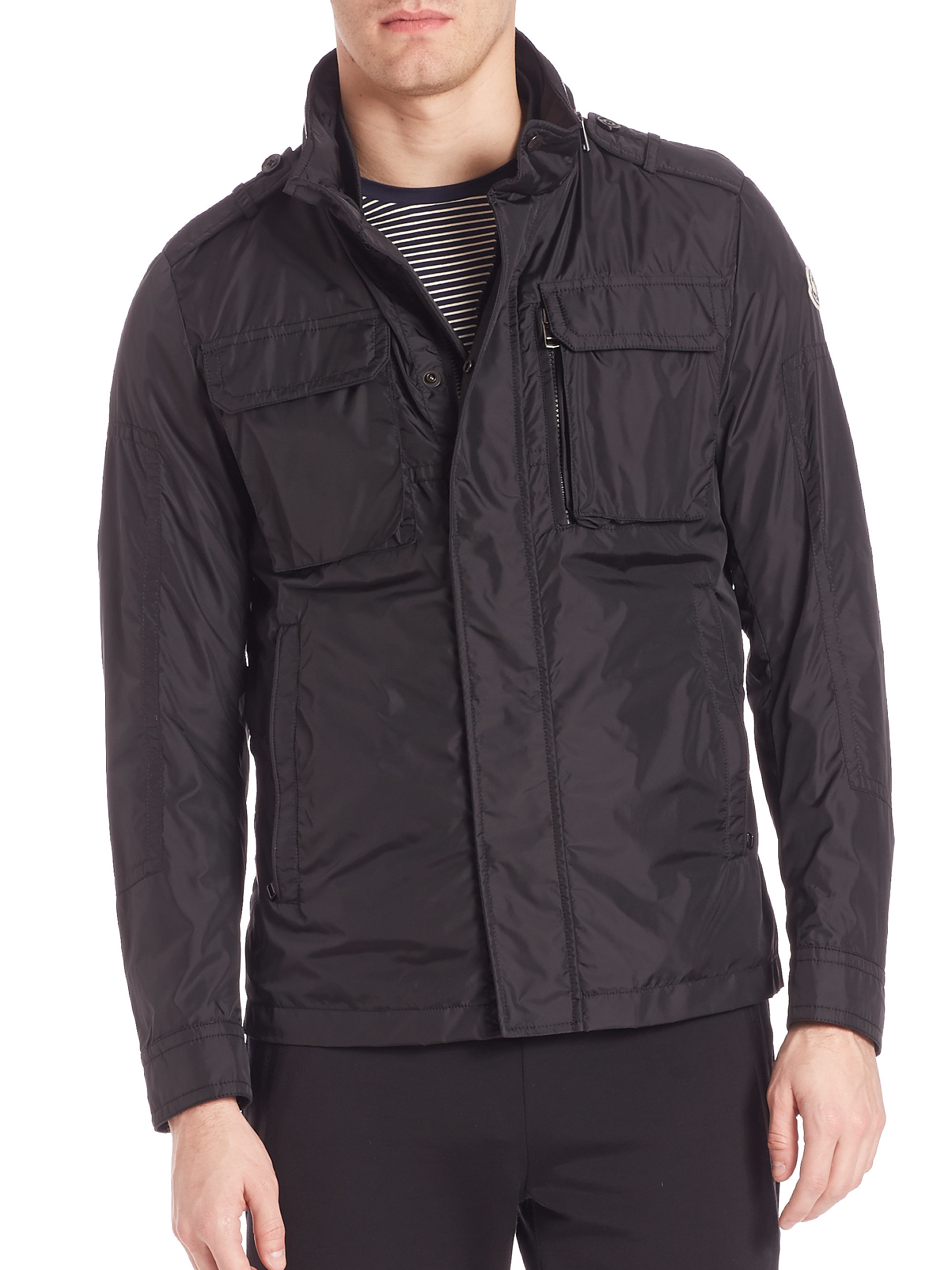 The Calvin Klein Men's Packable Down Jacket is a stylish quilted nylon with a front zipper as well as zippered side and chest pockets. It comes in classic colors such as black, blue and dark indigo and can be tucked inside its accompanying pouch.