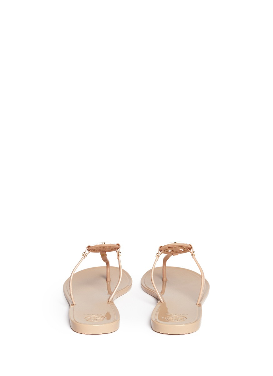 a4e7d3e61d130c Lyst - Tory Burch  Mini Miller  Crystal Logo Jelly Thong Sandals in ...