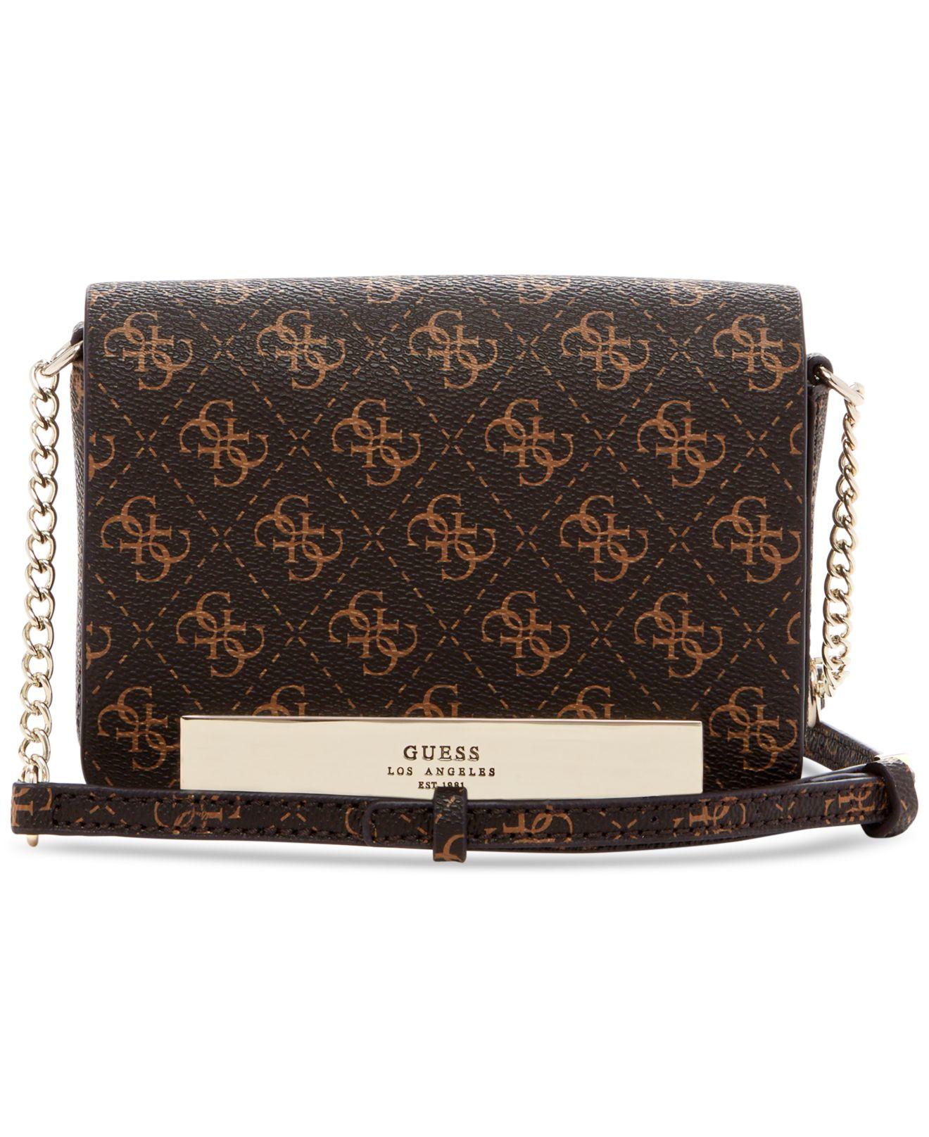 Lyst Guess Isla Pee Flap Mini Crossbody Bag In Brown 5b8604add5db7