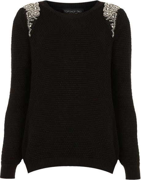 This black and pink cotton logo crest knit jumper from Balmain features a round neck, long sleeves and a ribbed hem and cuffs. Olivier Rousteing continues his evolution of Balmain's classic styles into the brand's AW18 collection and beyond.