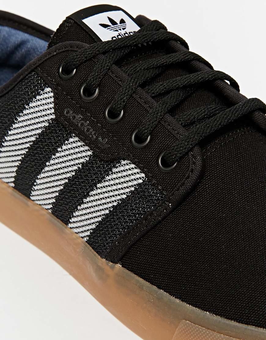 adidas originals woven trainers