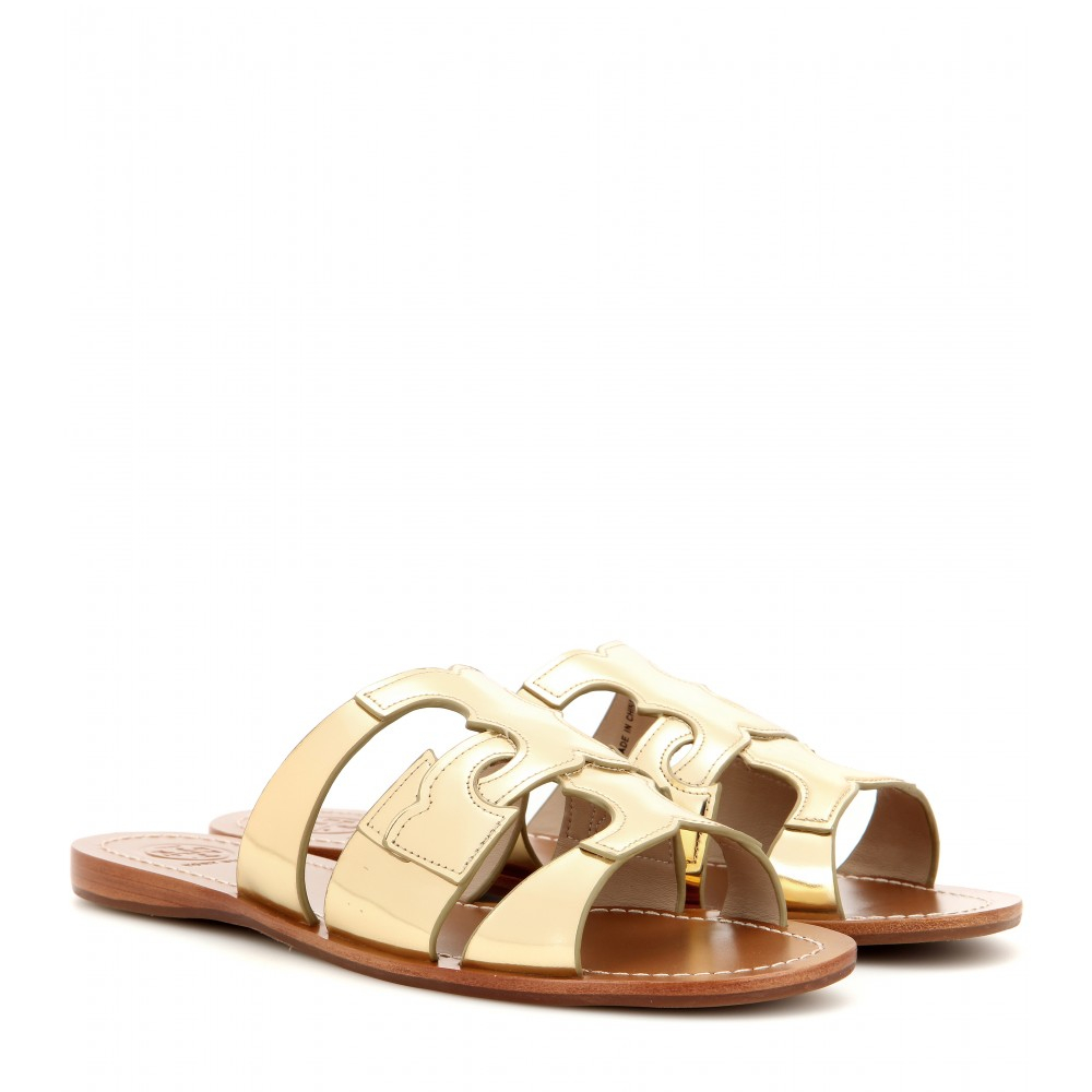 add36a9ef Tory Burch Anchor T Metallic Leather Flat Sandals in Gold