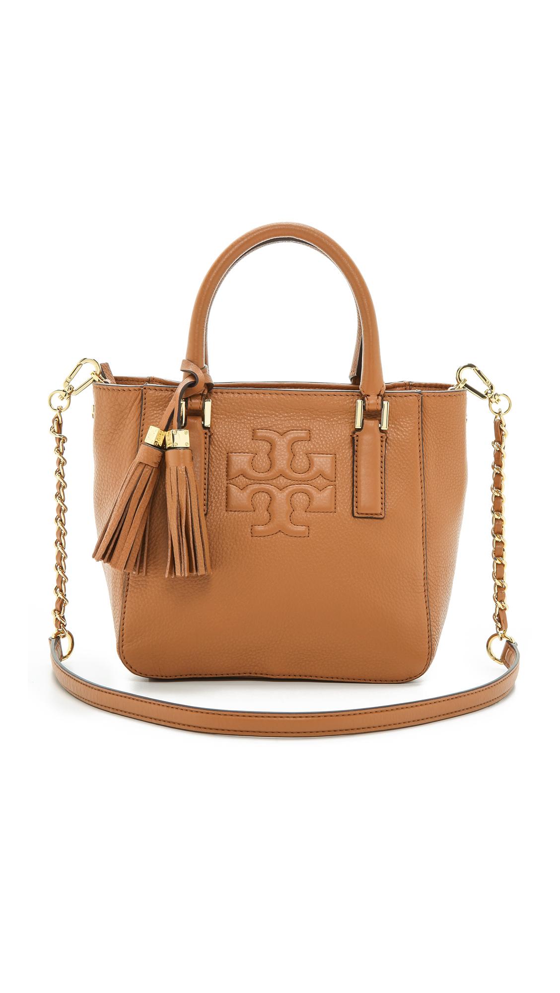 674069ff356f Lyst - Tory Burch Thea Mini Bucket Bag - Kir Royale in Brown