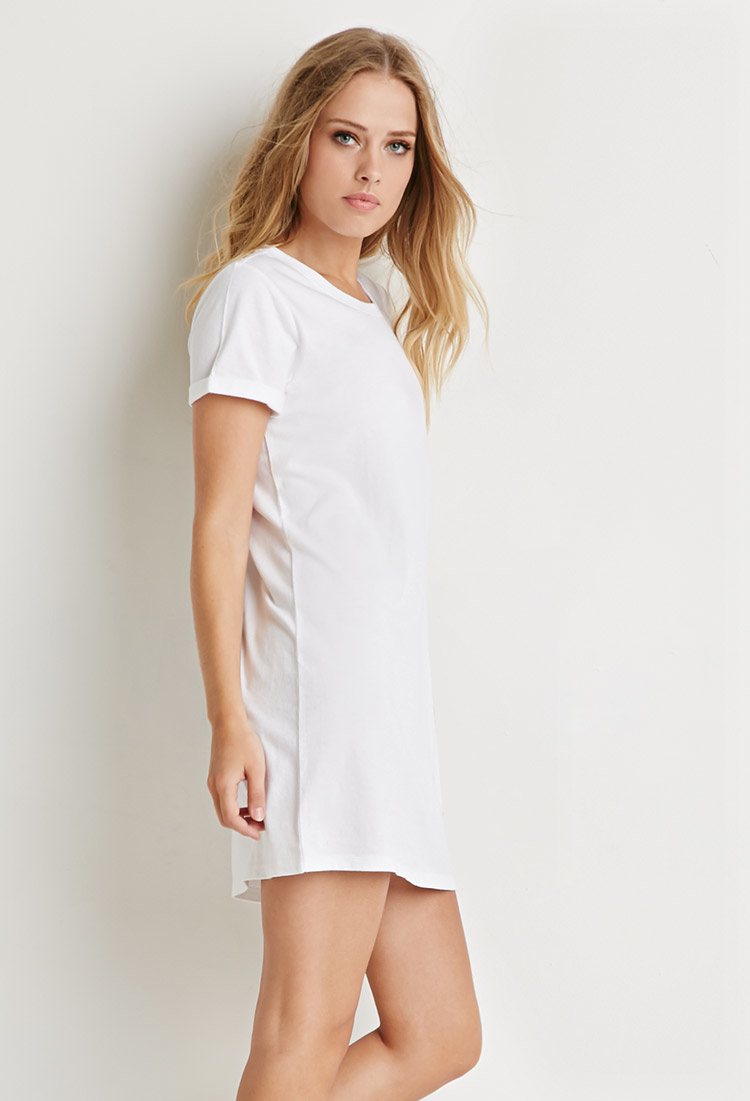 Her comfiest T-shirt becomes her cutest dress, with embroidery at the neckline, ruching at the shoulders, and gathers at the waist. Soft and well-textured in slubbed organic-cotton jersey.