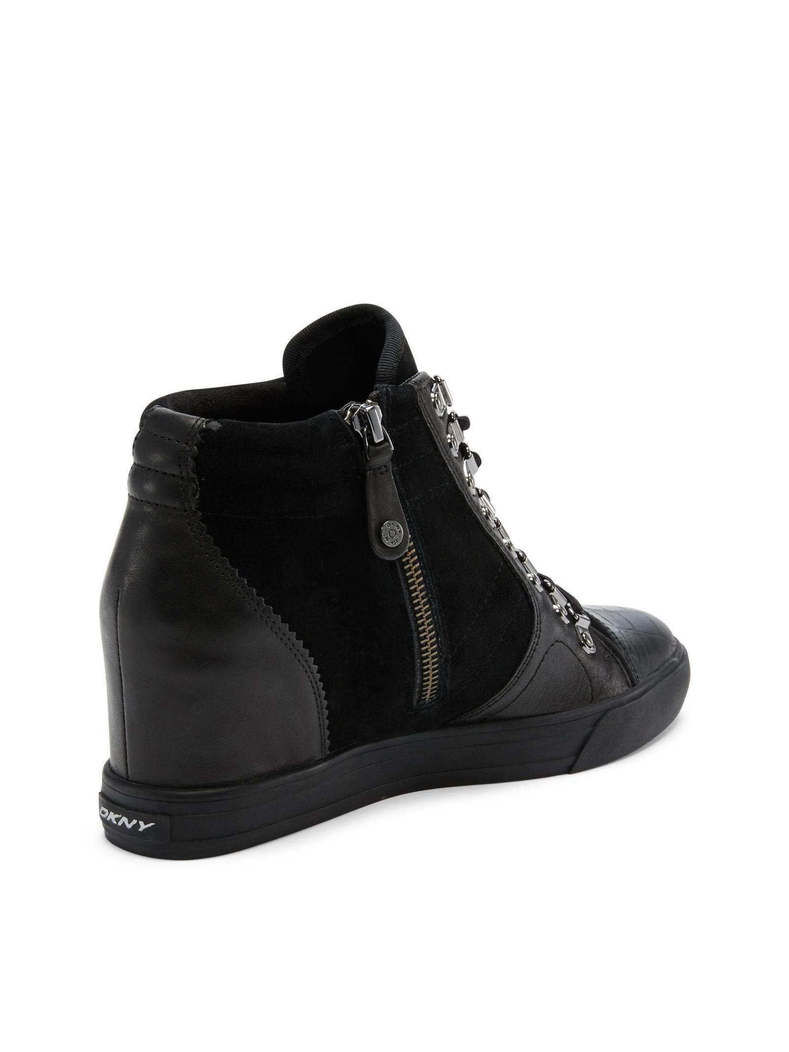 afe98c7799d6 Lyst - DKNY Cindy Wedge Sneaker in Black