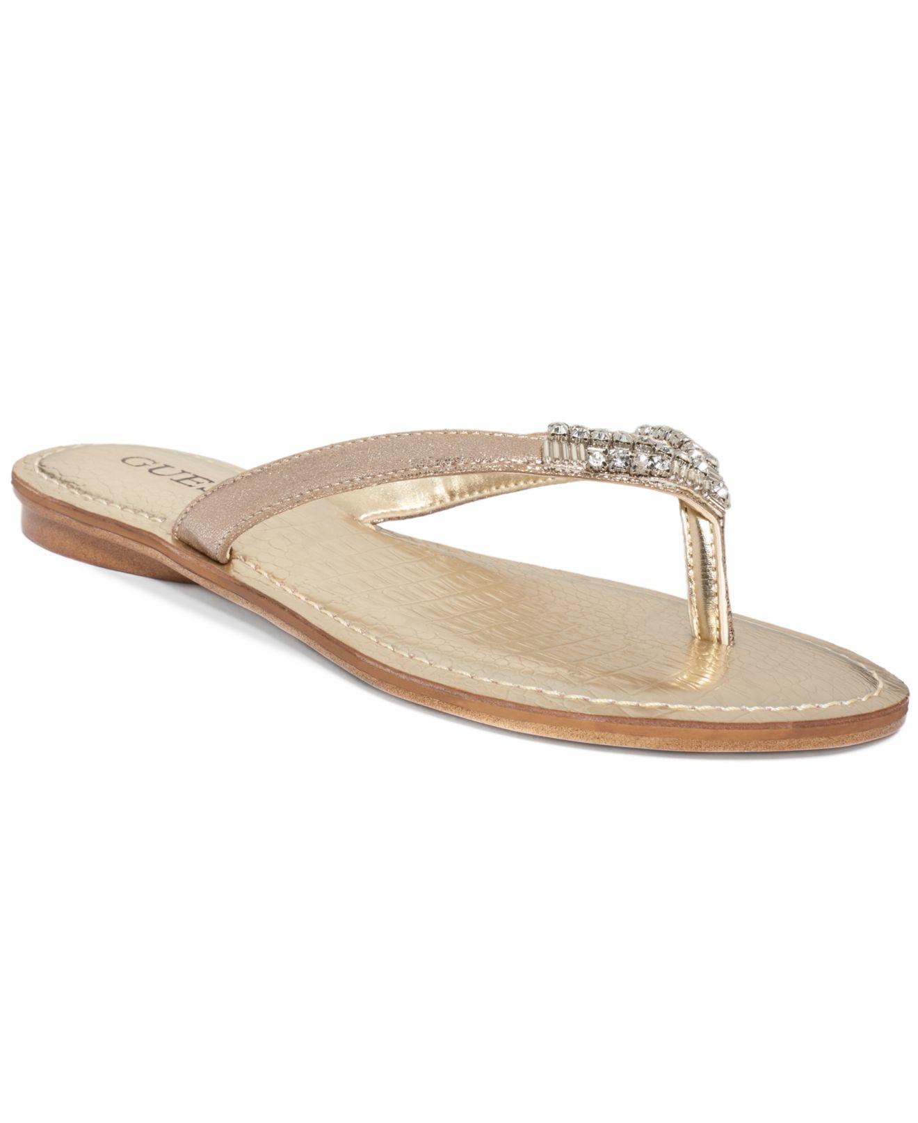 Lyst Guess Women S Griffa Flip Flop Sandals In Metallic