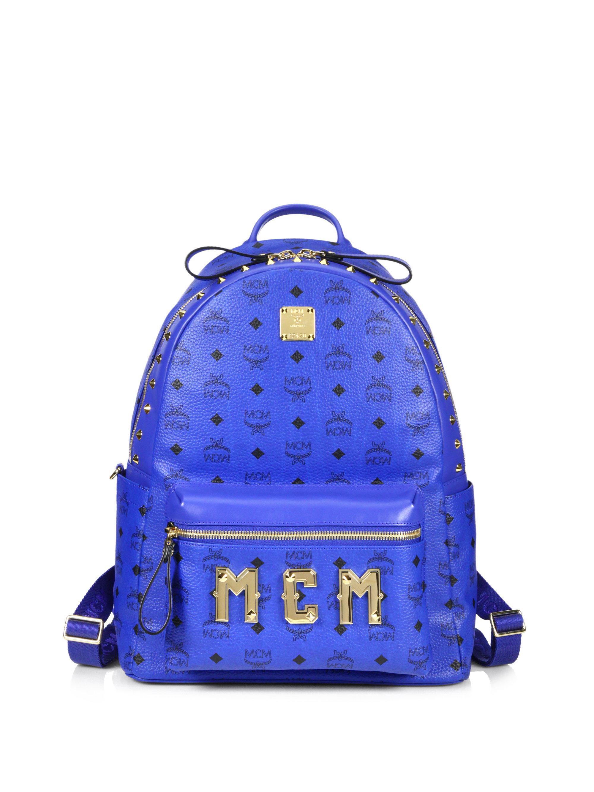 mcm visetos stark monogram backpack in blue for men lyst. Black Bedroom Furniture Sets. Home Design Ideas