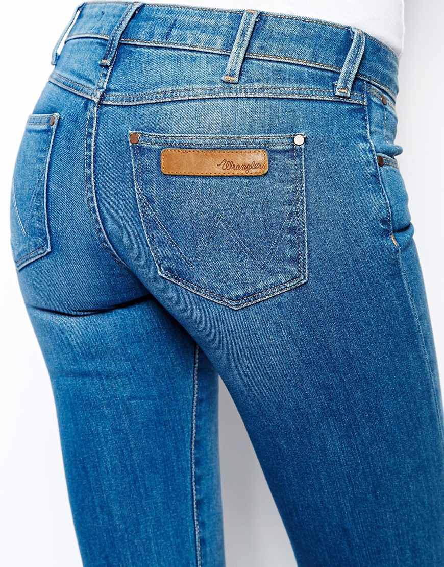 lyst wrangler catrin low waist bootcut jeans in blue. Black Bedroom Furniture Sets. Home Design Ideas