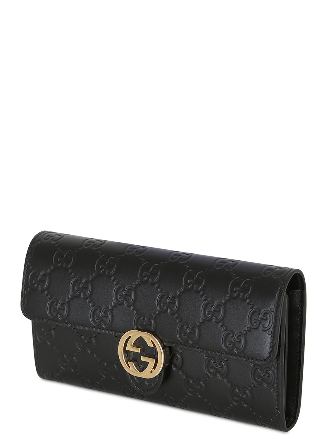 gucci gg embossed leather wallet in black lyst