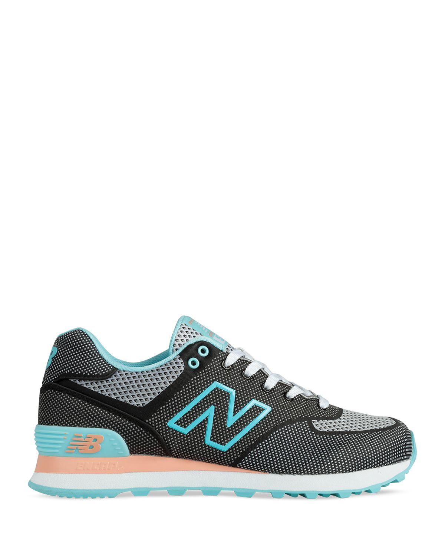 new balance wl574 sneakers in black black blue lyst. Black Bedroom Furniture Sets. Home Design Ideas