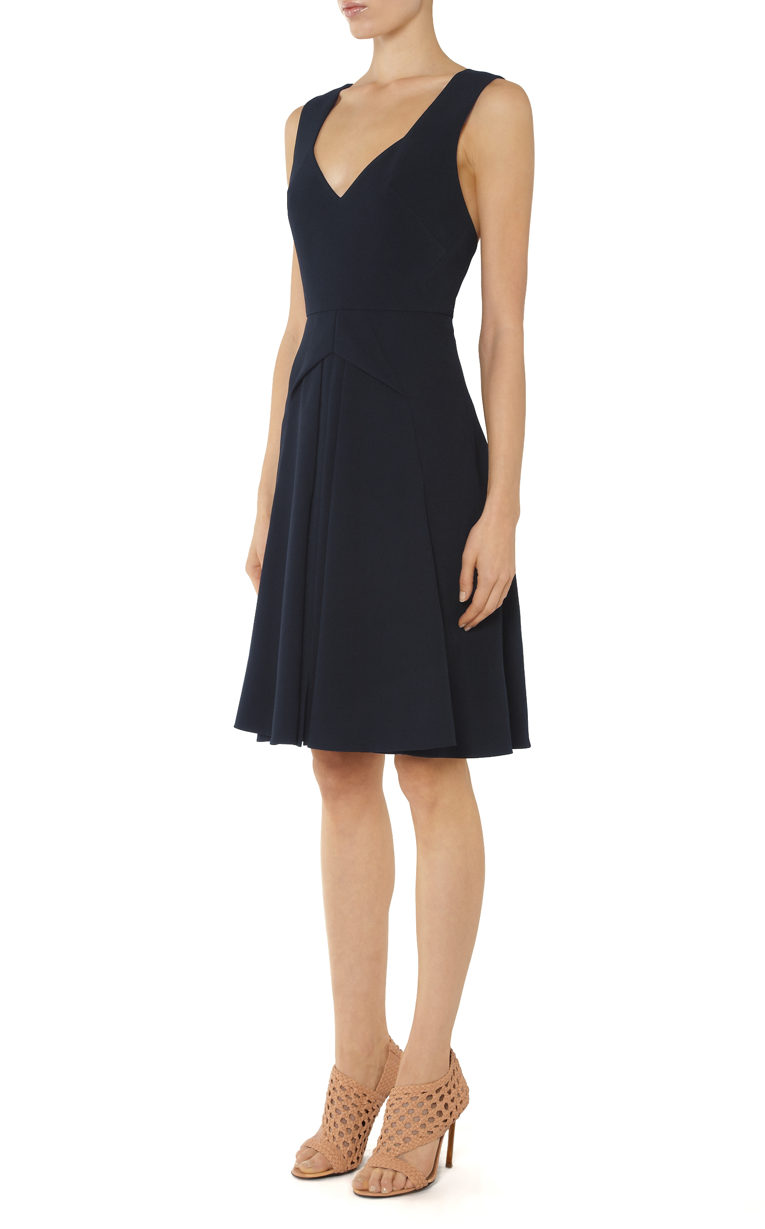 Dress is composed of a navy blue hued crepe fabric that offers a form hugging fit with a moderate stretch. Includes a smooth knit lining. Model is 5'7 with a 34