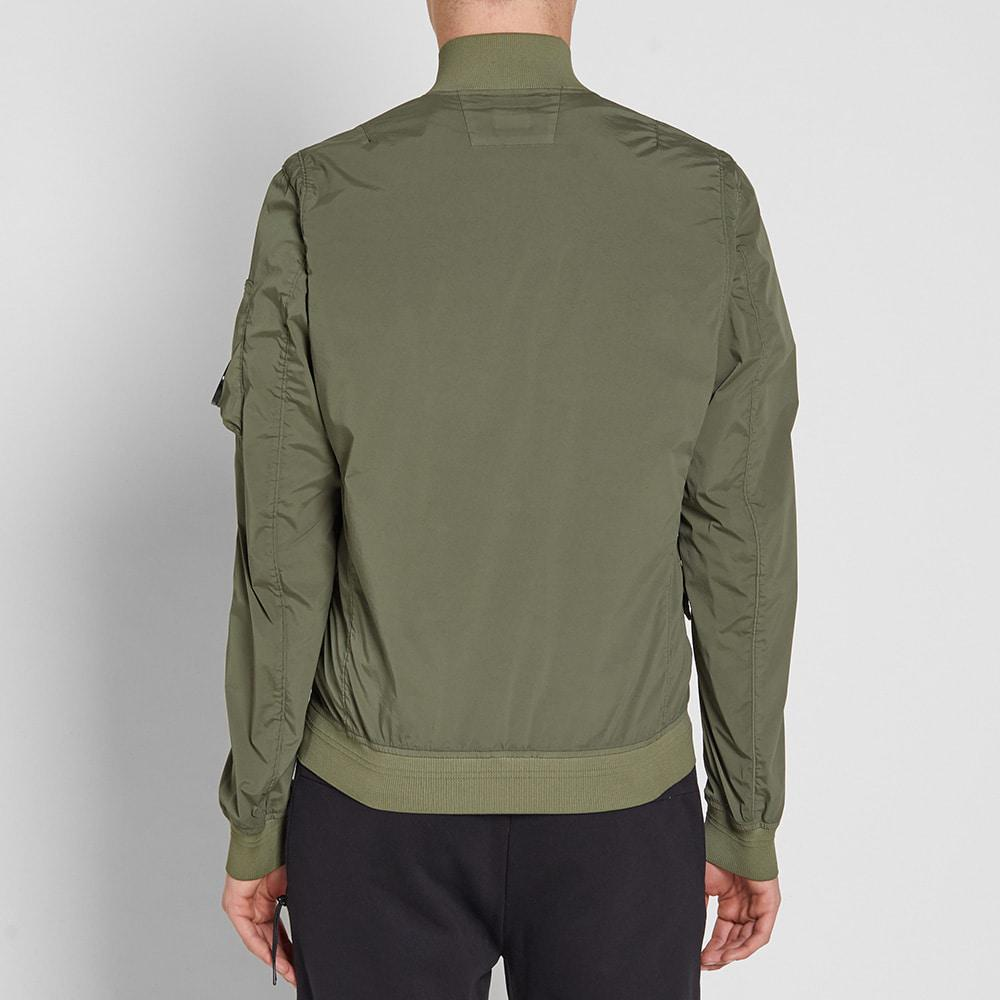 C P Company Synthetic Nycra Arm Lens Bomber Jacket in Green for Men