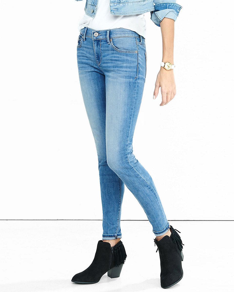 Lyst - Express Mid Rise Faded Medium Wash Jean Legging in Blue