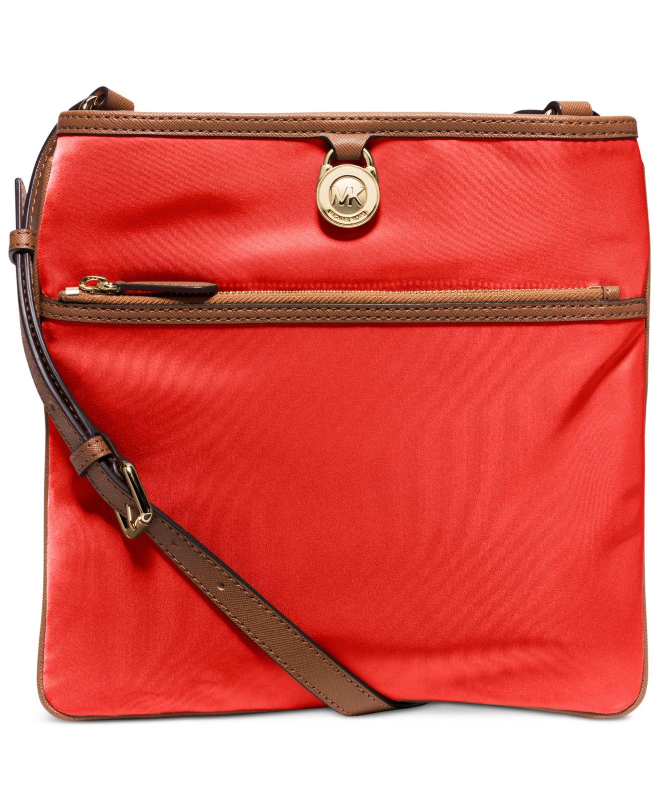 8cfeab439e9b ... low price lyst michael kors michael kempton large pocket crossbody in  red 3598d e51b4