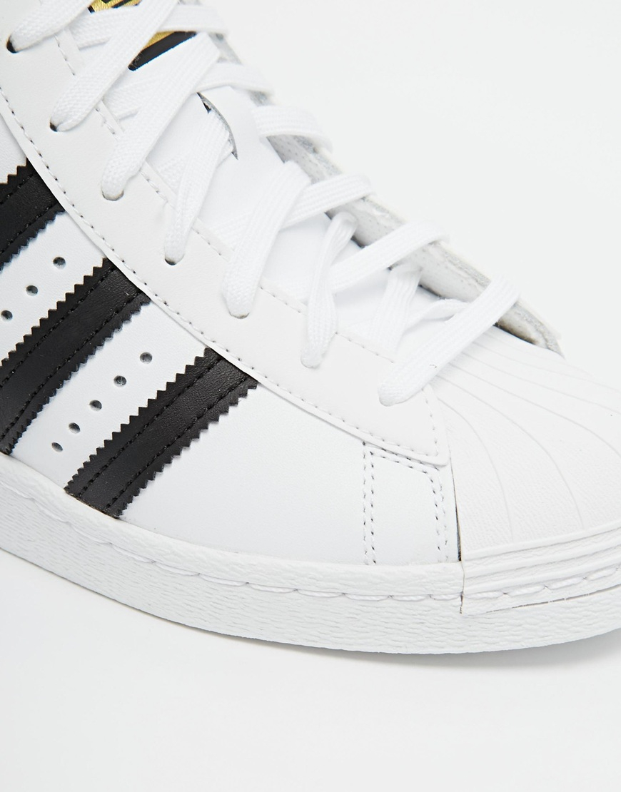 timeless design 8a87a e5206 Adidas Originals Superstar Concealed Wedge White High Top Sneakers