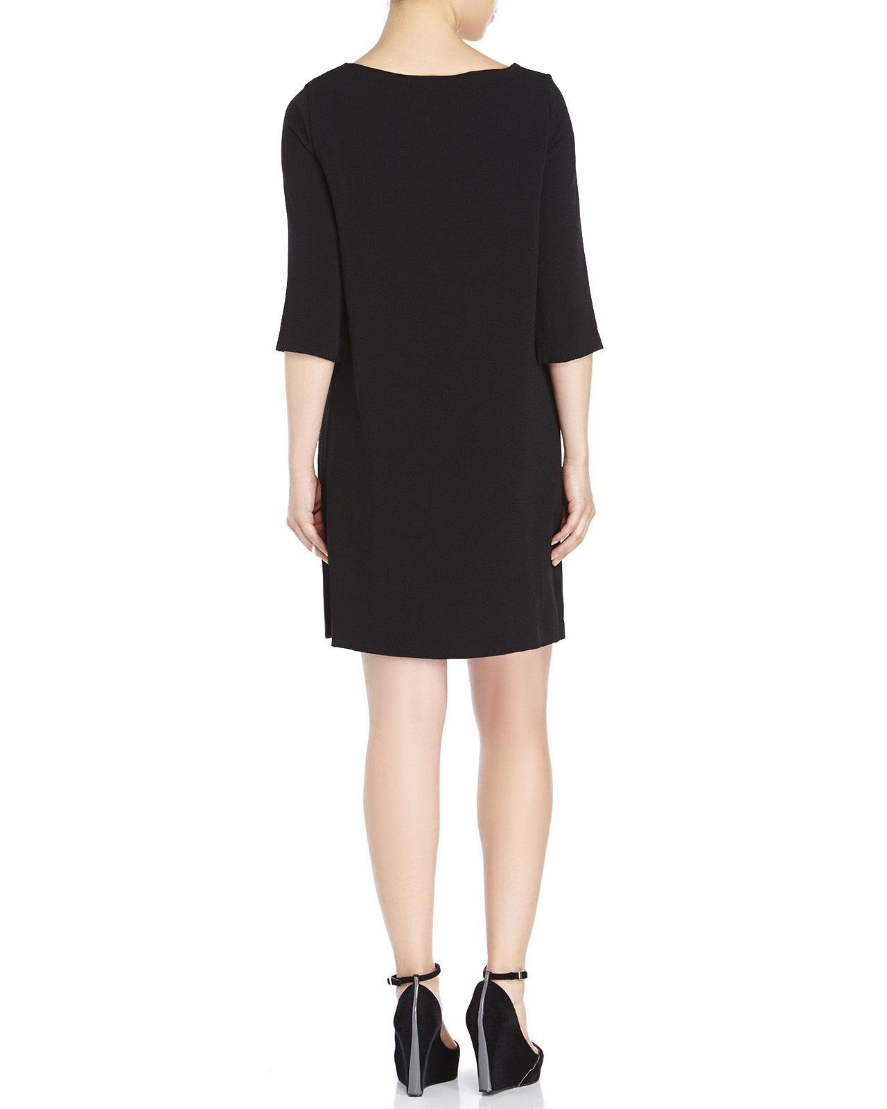 Stitching along the sides subtly defines the body of this effortless shift dress, while an inverted pleat down the center accentuates its elegant drape. Relaxed fit. Intended to hit at the knee.