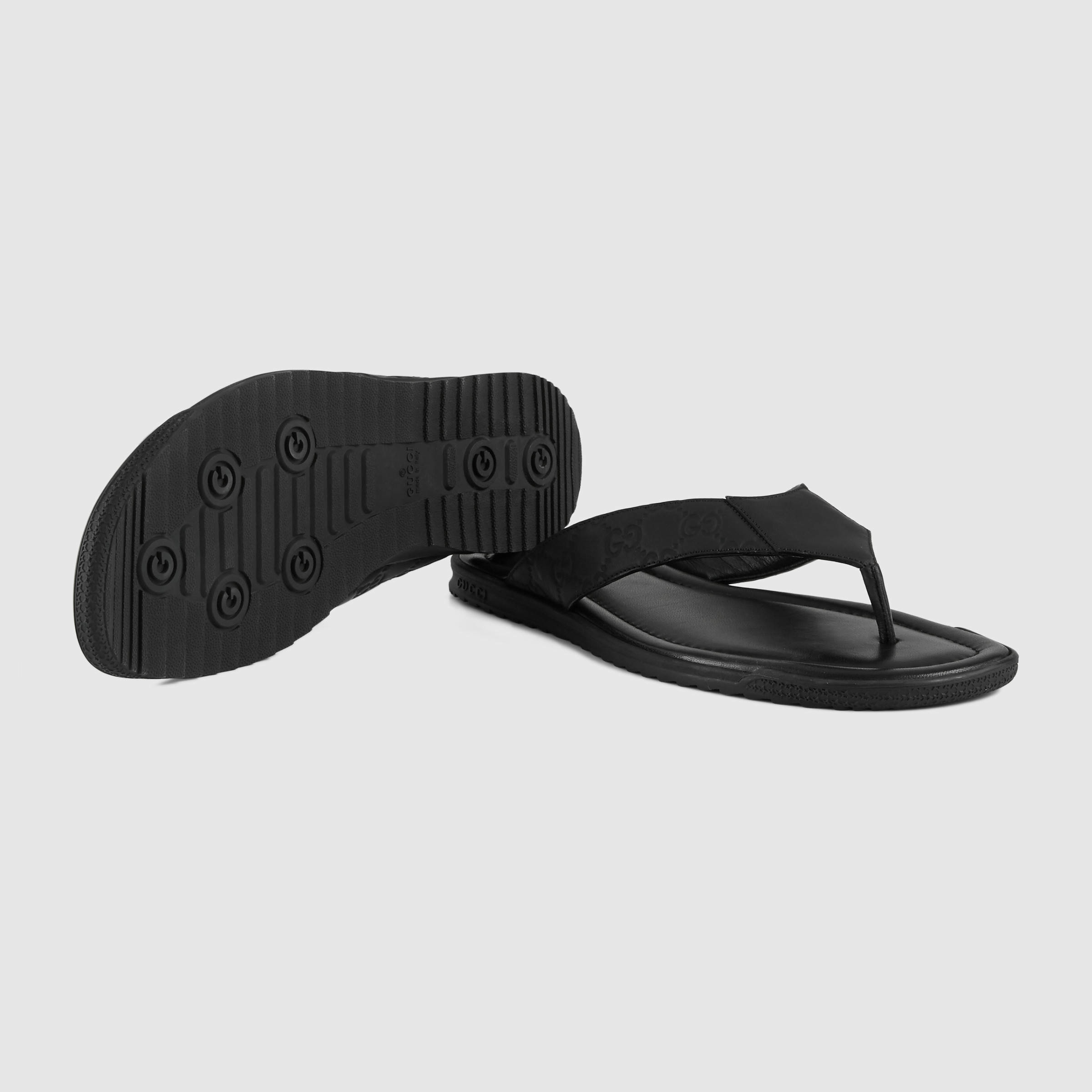 8747d7e07168 Gucci Rubberized Leather Thong Sandal in Black for Men - Lyst