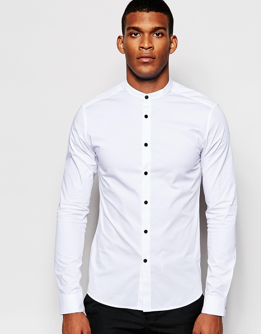 You can wear a fitted white shirt with a jumper layered on top with a pair of skinny or slim fit black jeans. This will give you a smart casual look which is perfect for a trip to the pub or local bar where you don't have to look overly smart but you still want to look nice.