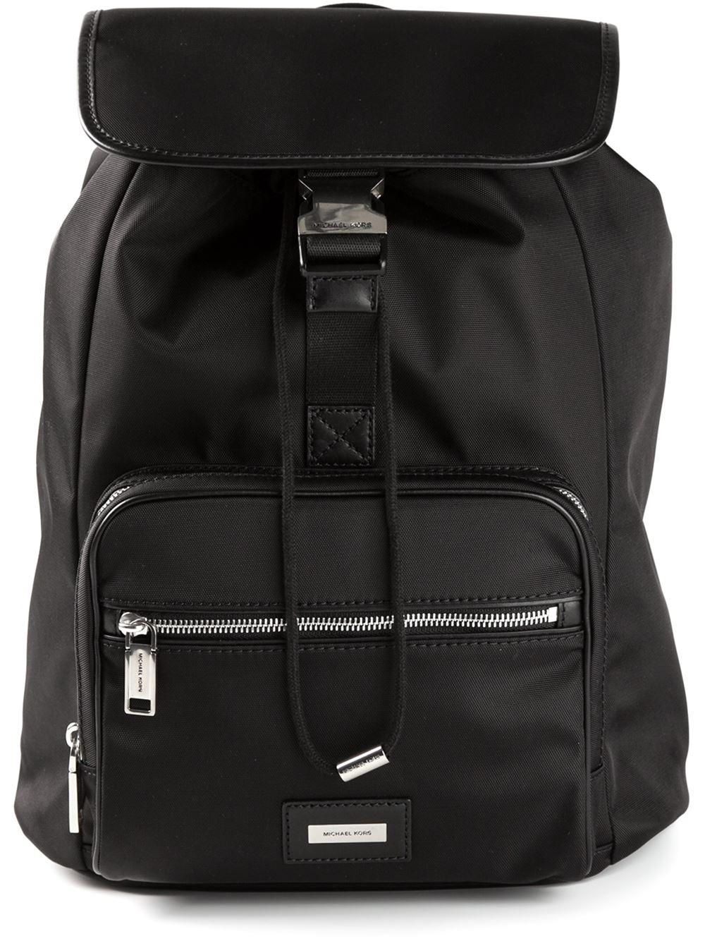 ace7038b68c9 ... shop michael kors logo plaque backpack in black for men lyst df554 0b70d