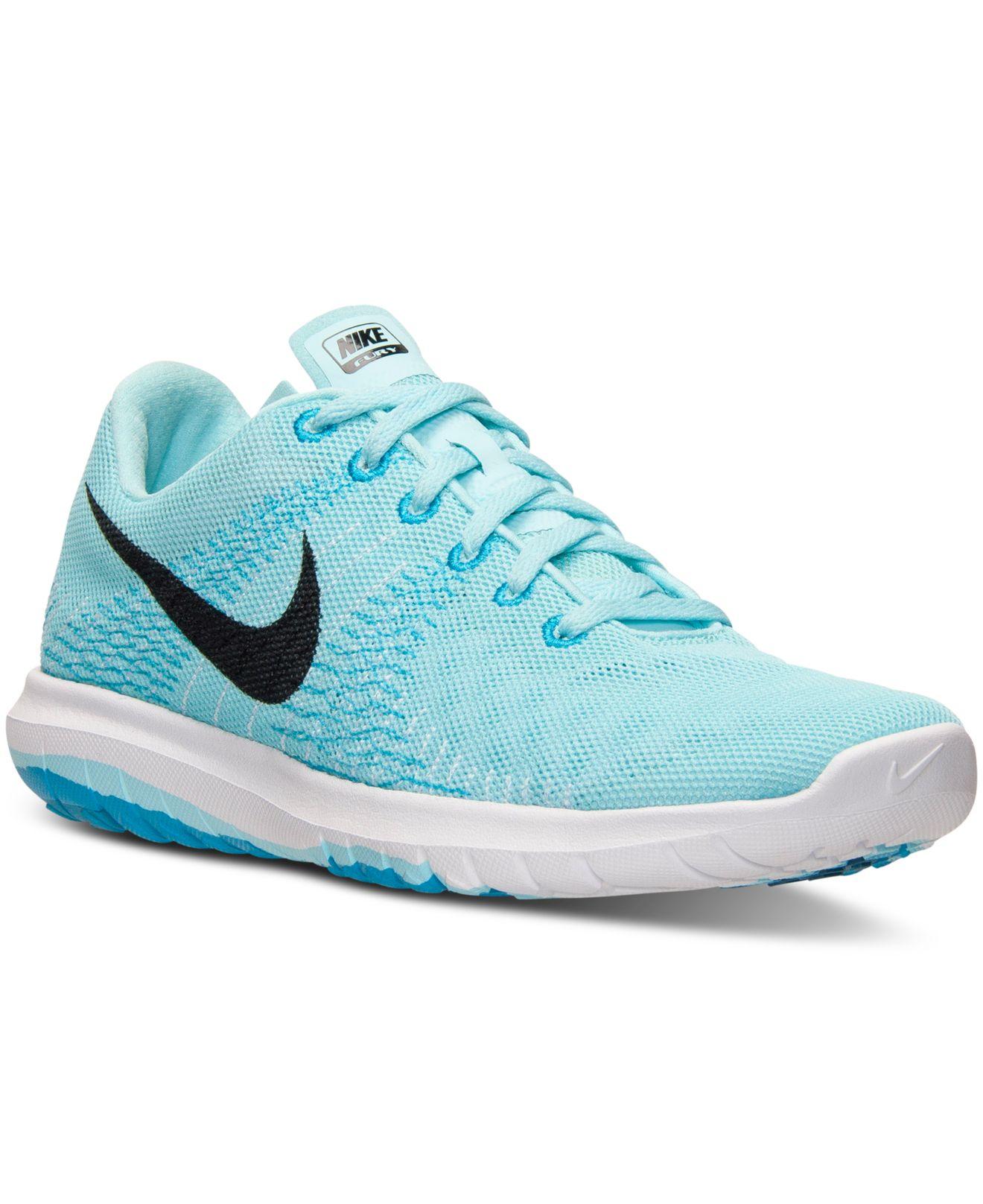 Lyst - Nike Women s Flex Fury Running Sneakers From Finish Line in Blue c141de669e