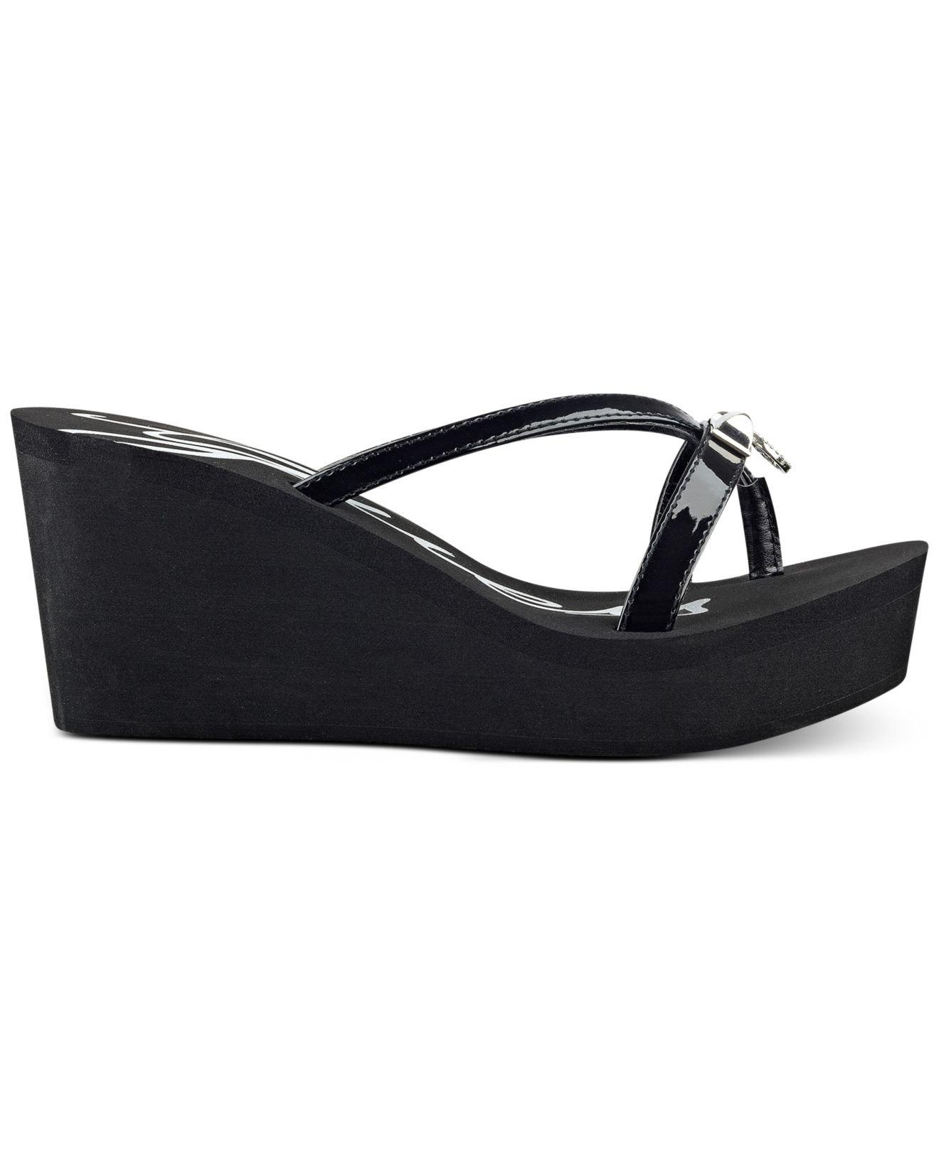10295f73266d0 Lyst - Guess Women s Shea Platform Wedge Flip-flop Sandals in Black