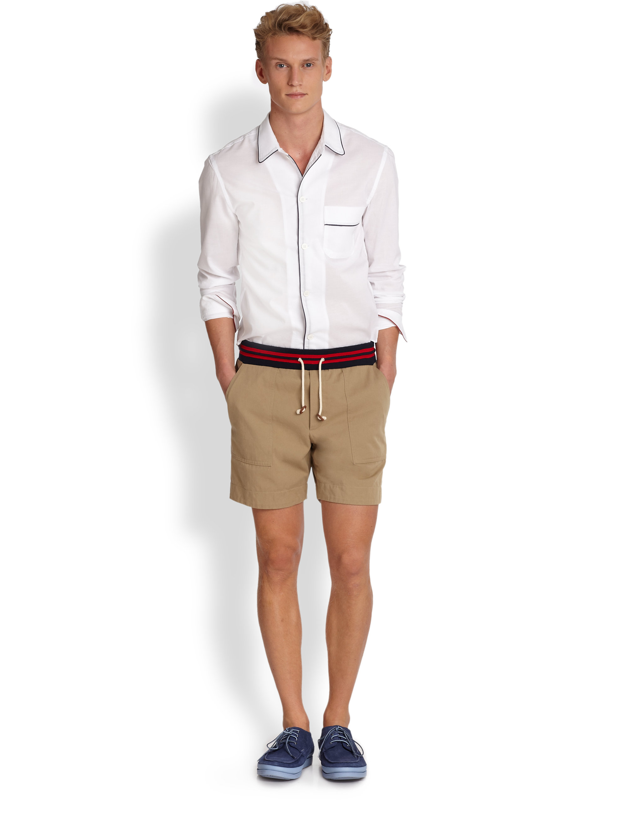 a5ae51329 Boat shoes, high tight chino shorts, and a delicate button up shirt with  the sleeves rolled up.
