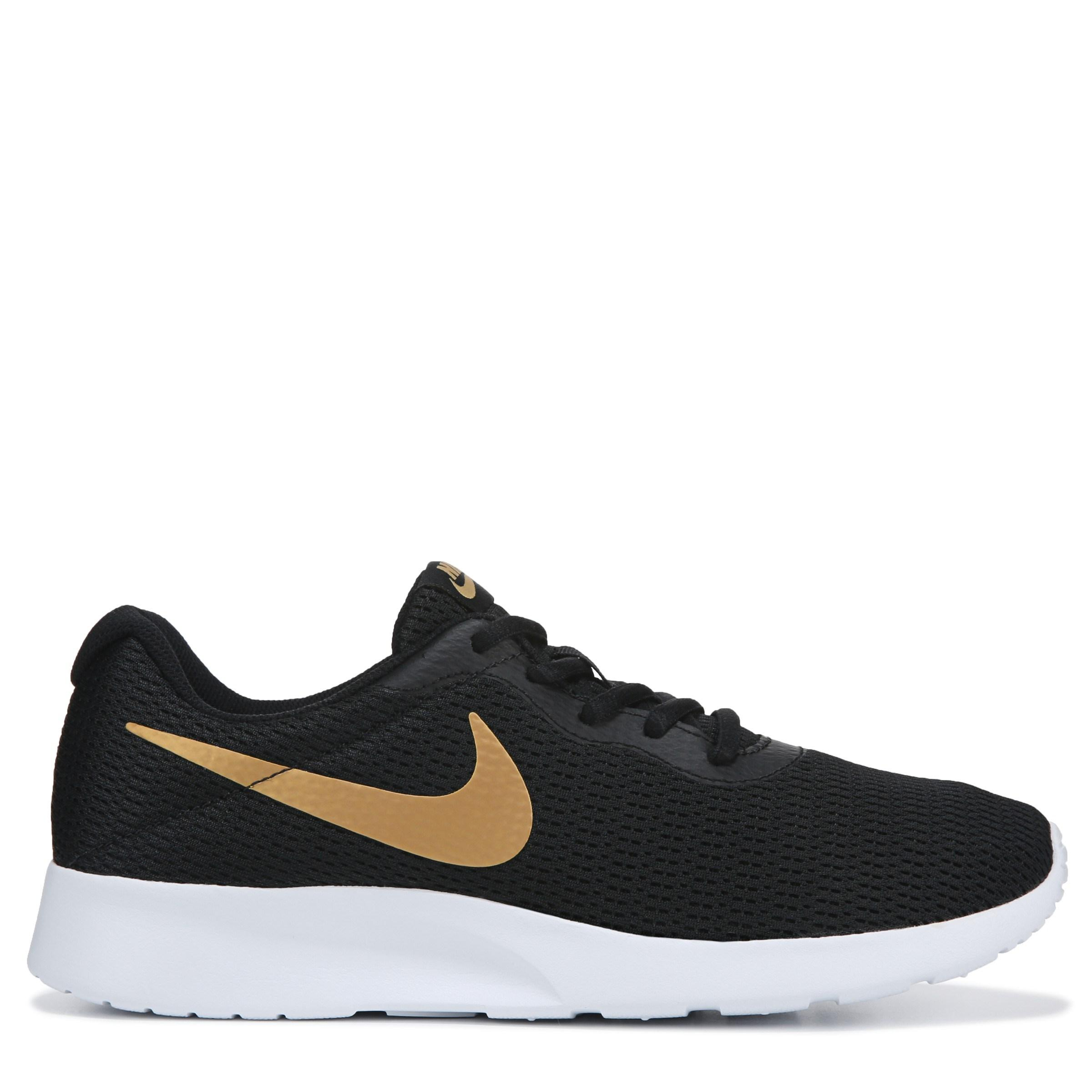 Nike Tanjun Sneakers in Black/Gold