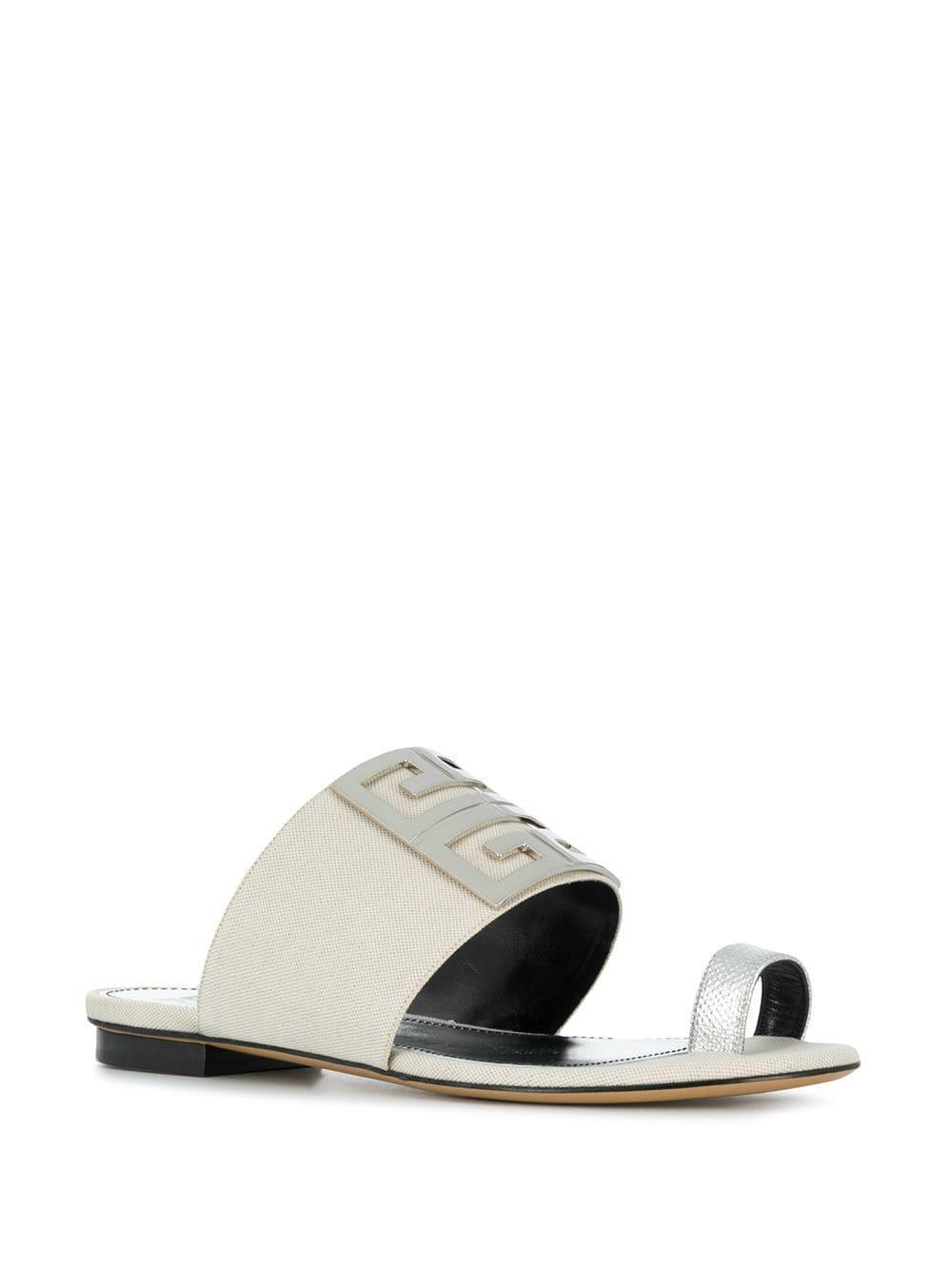 777274e4d16 Lyst - Givenchy Logo Plaque Flat Sandals