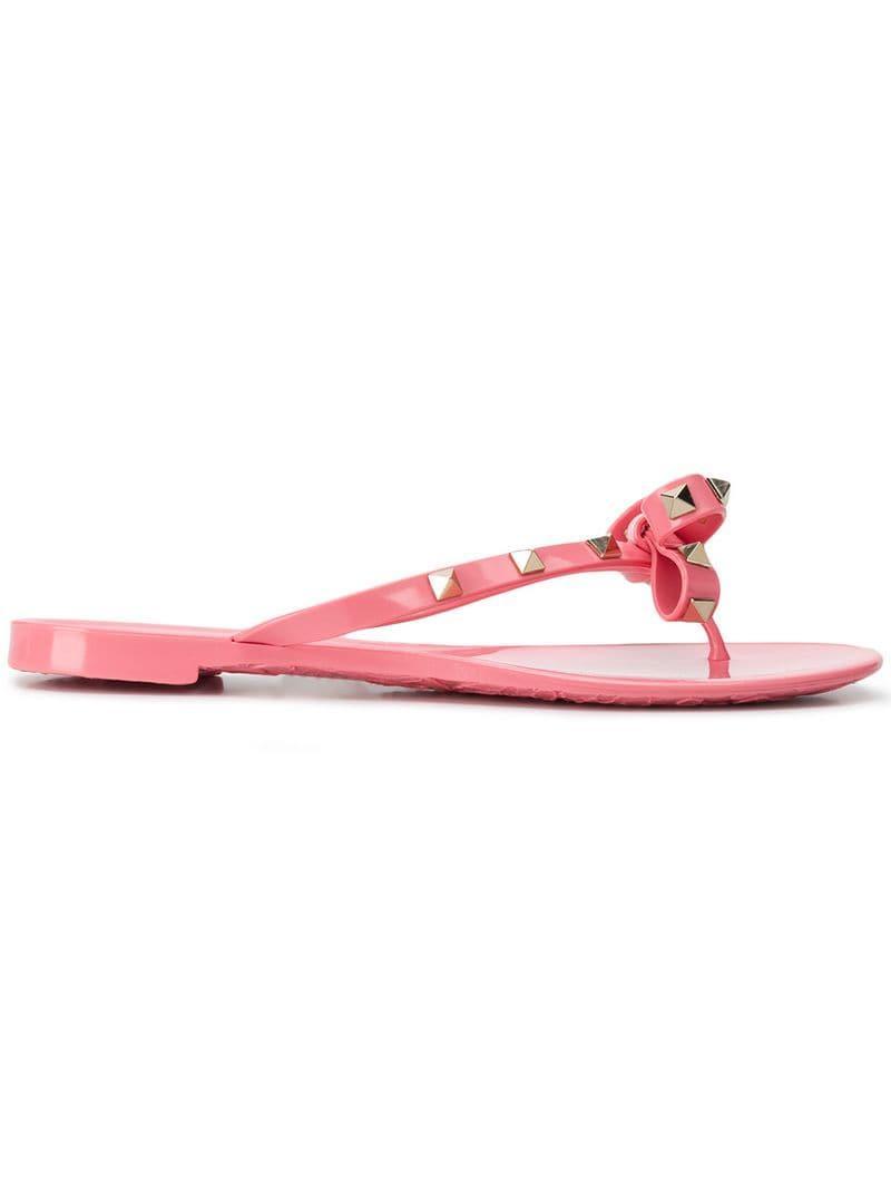 ce471a7d4e5d Valentino Garavani Rockstud Bow Flip Flops in Pink - Lyst