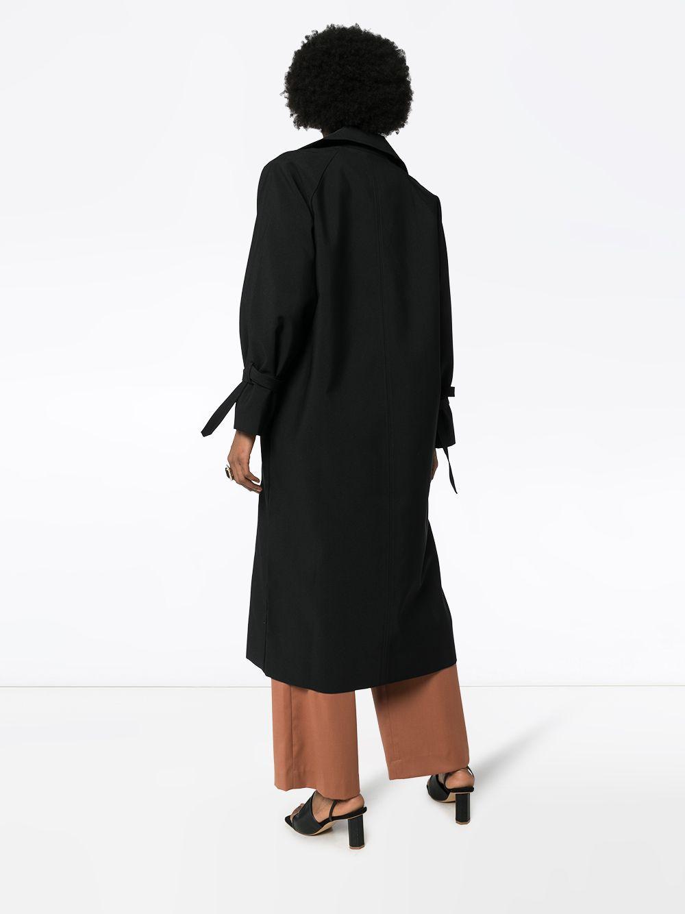 Gabardina con doble botonadura Totême de Tejido sintético de color Negro