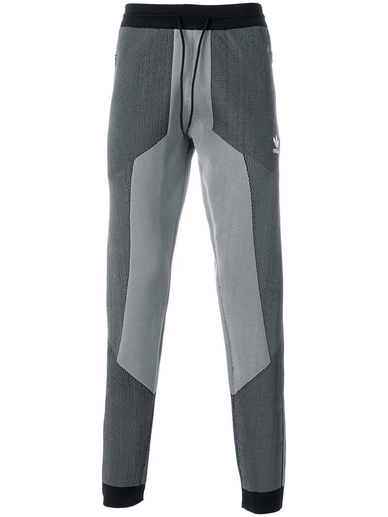 lyst adidas originals plgn track pants in gray for men