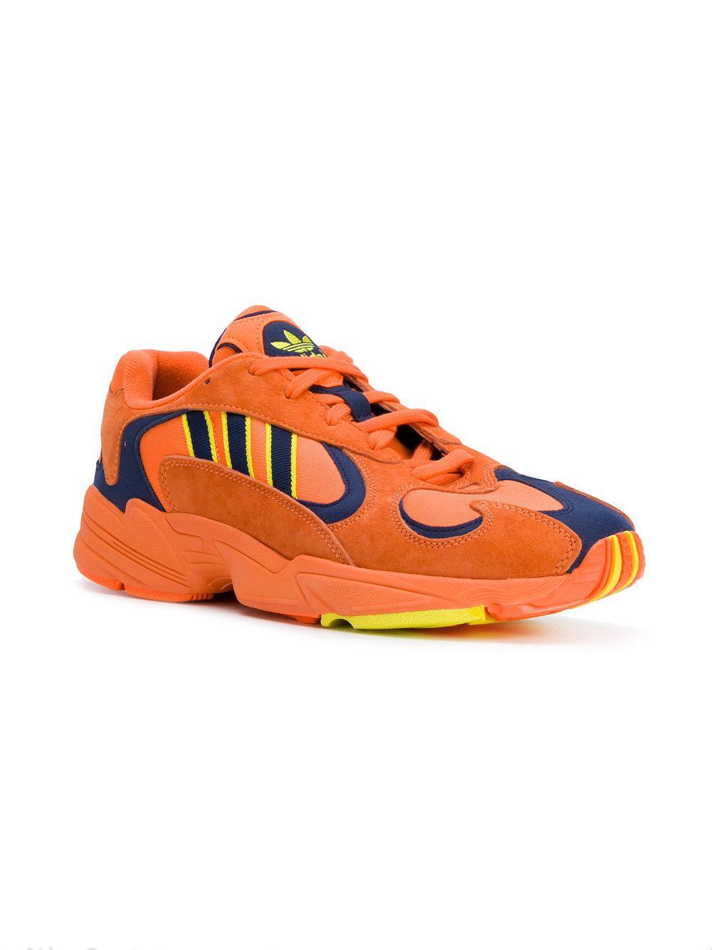 adidas Leather Yung 1 Sneakers in Yellow & Orange (Orange)
