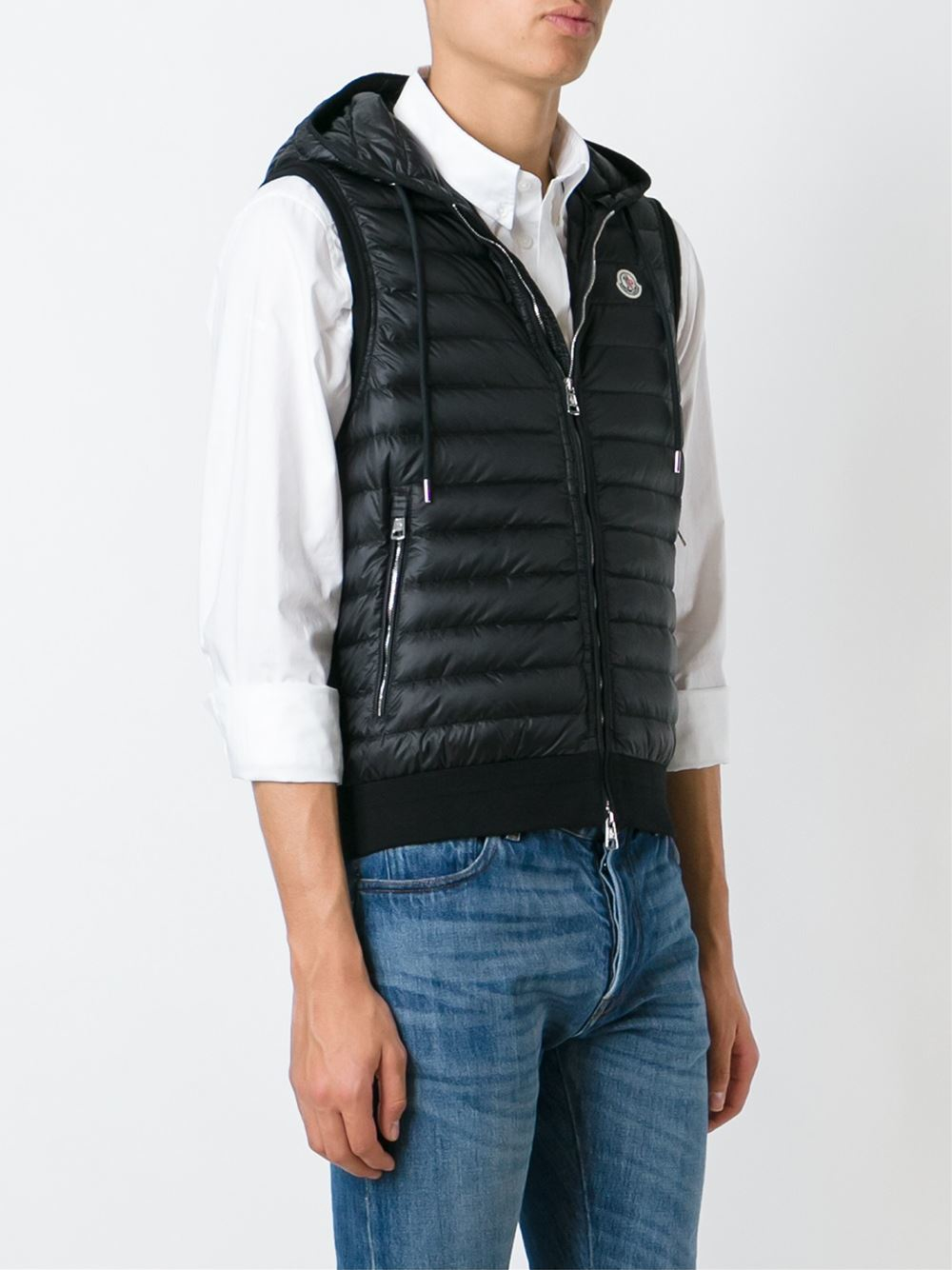 "Wool and cashmere houndstooth down vest. The thickness of the wool and cashmere yarn gives the texture a weightless, velvety hand, and lends a special ""vintage"" effect to the traditional print."