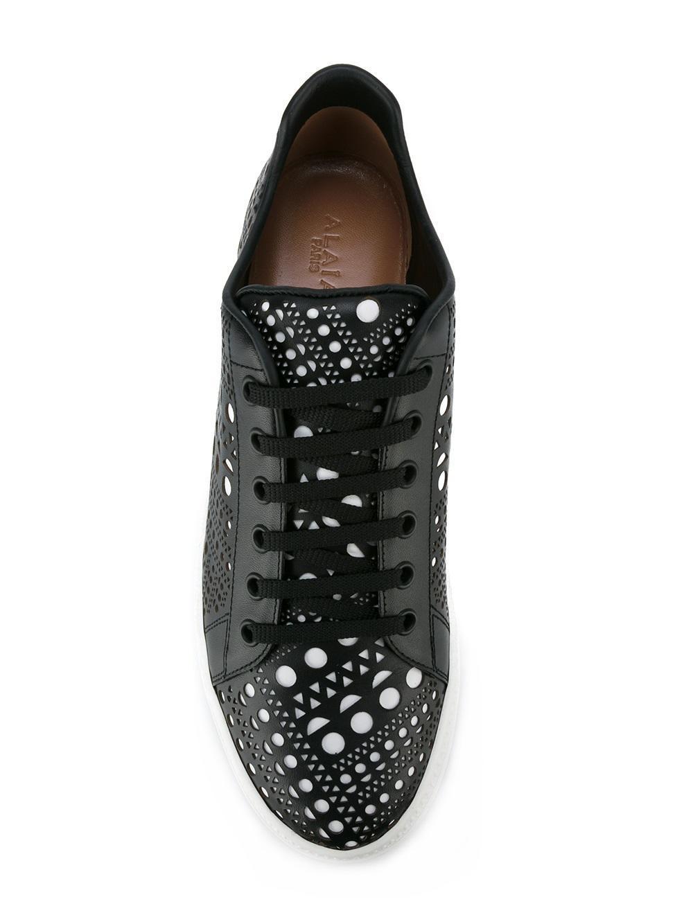 Alaïa Leather Laser Cut Sneakers in Black