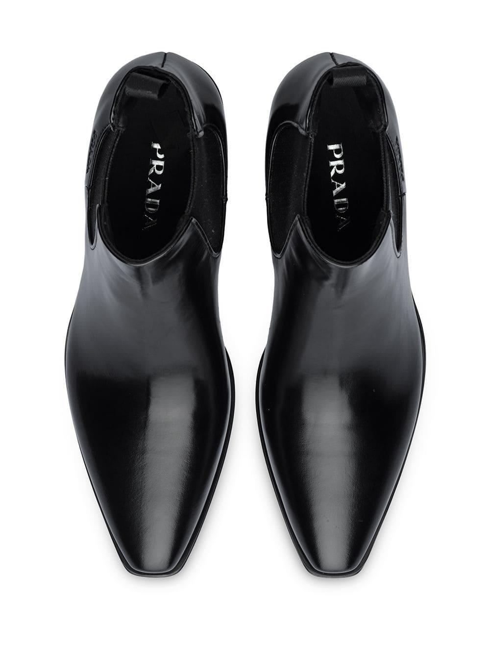 Botas Chelsea con tacón grueso Prada de Cuero de color Negro