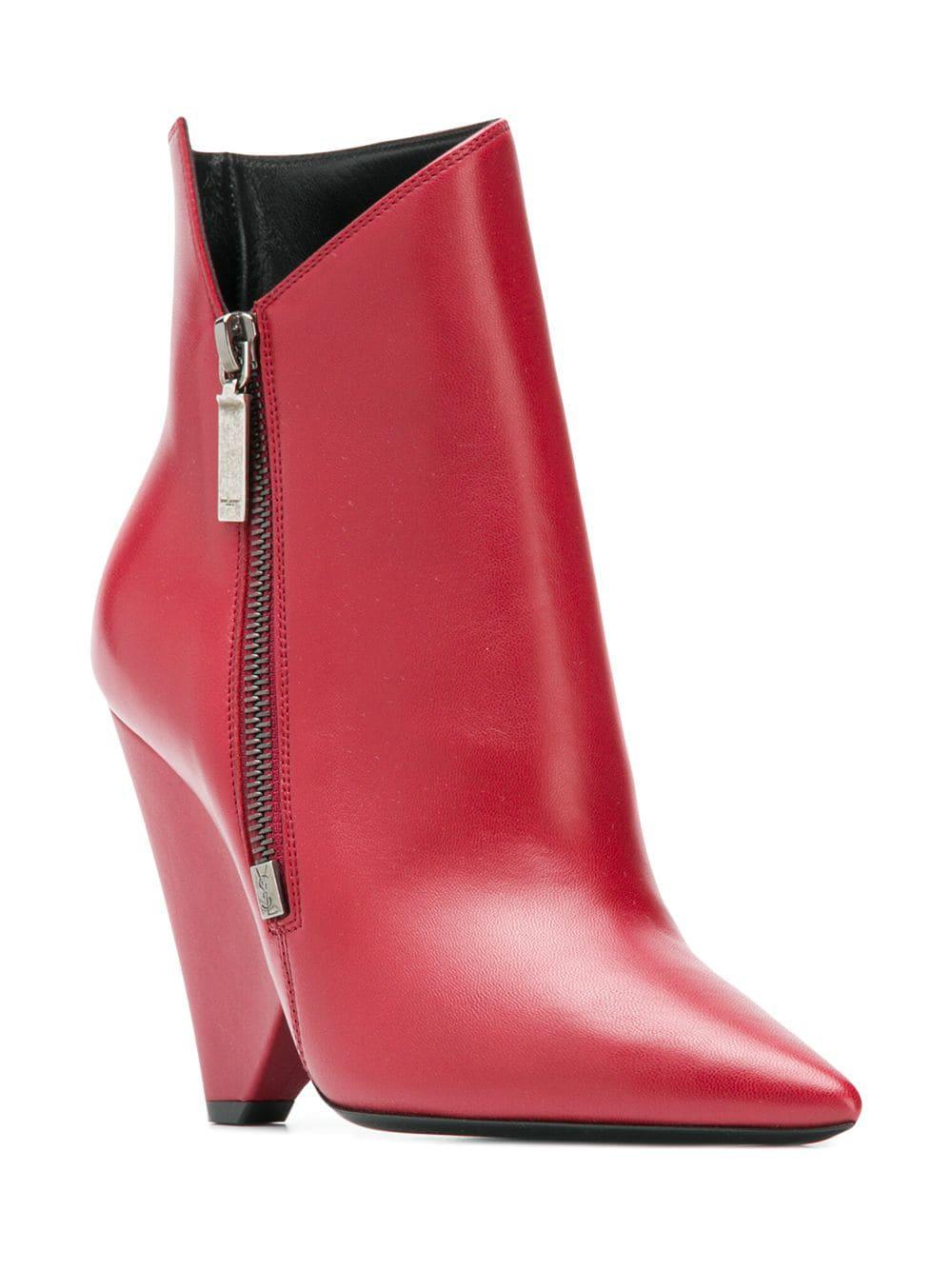 b2397a3ddab Lyst - Saint Laurent Niki 85 Asymmetric Boots in Red - Save 40%