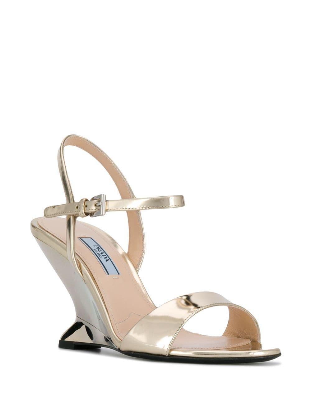 af763ad2ca7 Lyst - Prada Wedge Sandals in Metallic