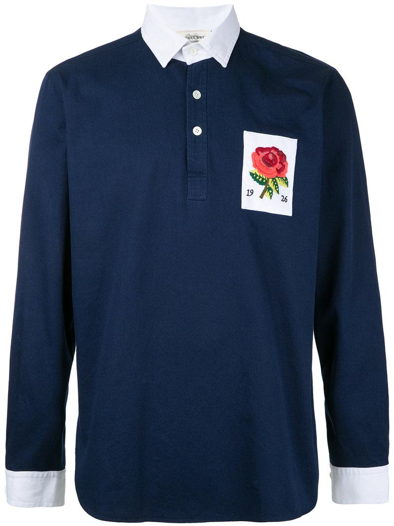 Kent curwen flower embroidered polo shirt in blue for