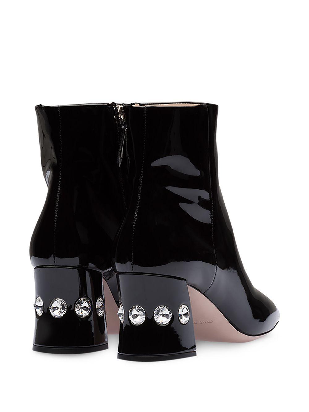 Botines con tacón con cristales Miu Miu de Cuero de color Negro