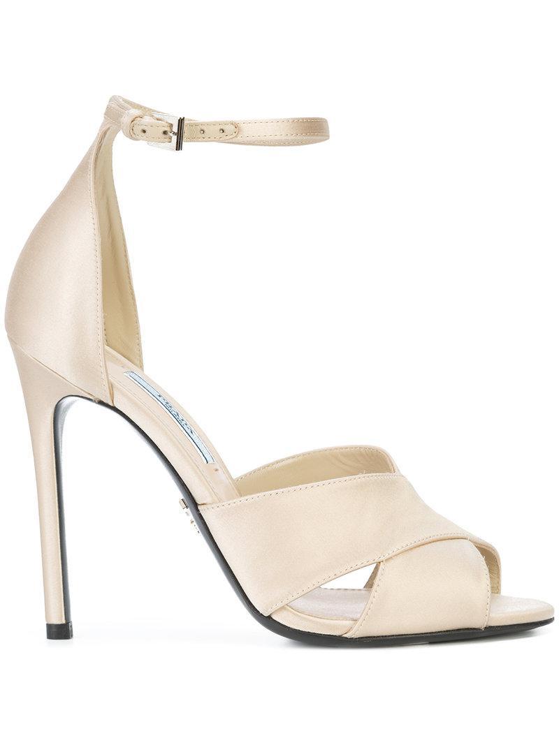0c969b01185 Lyst - Prada Crossover Stiletto Sandals in Natural