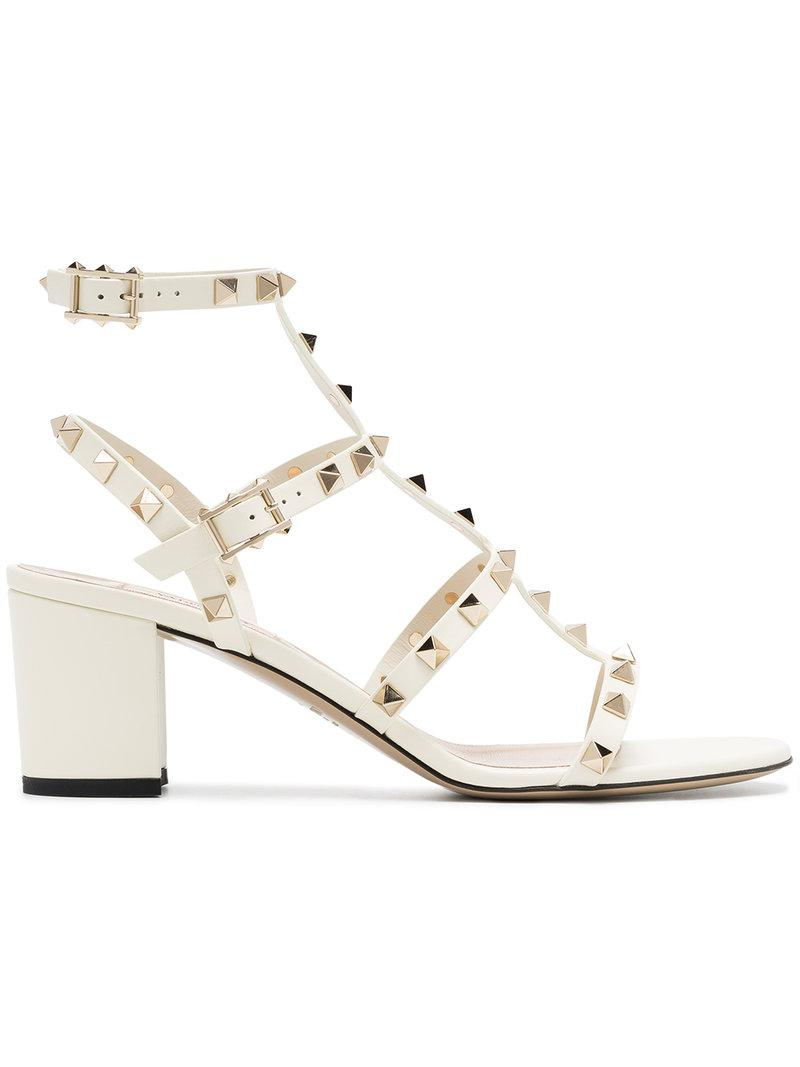 3432af60574 Lyst - Valentino Rockstud Patent Leather Sandals in White - Save ...
