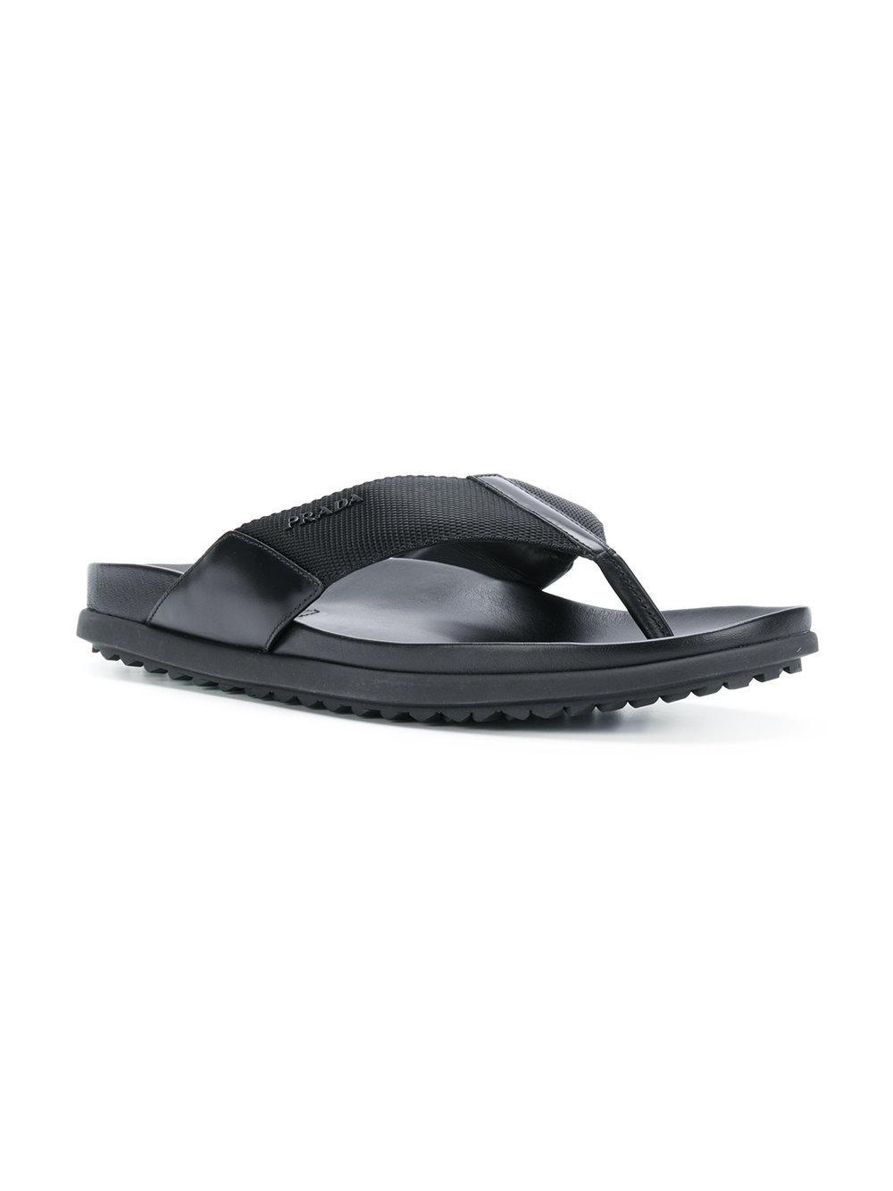 508954291d82e6 Lyst - Prada Metal Logo Flip Flops in Black for Men