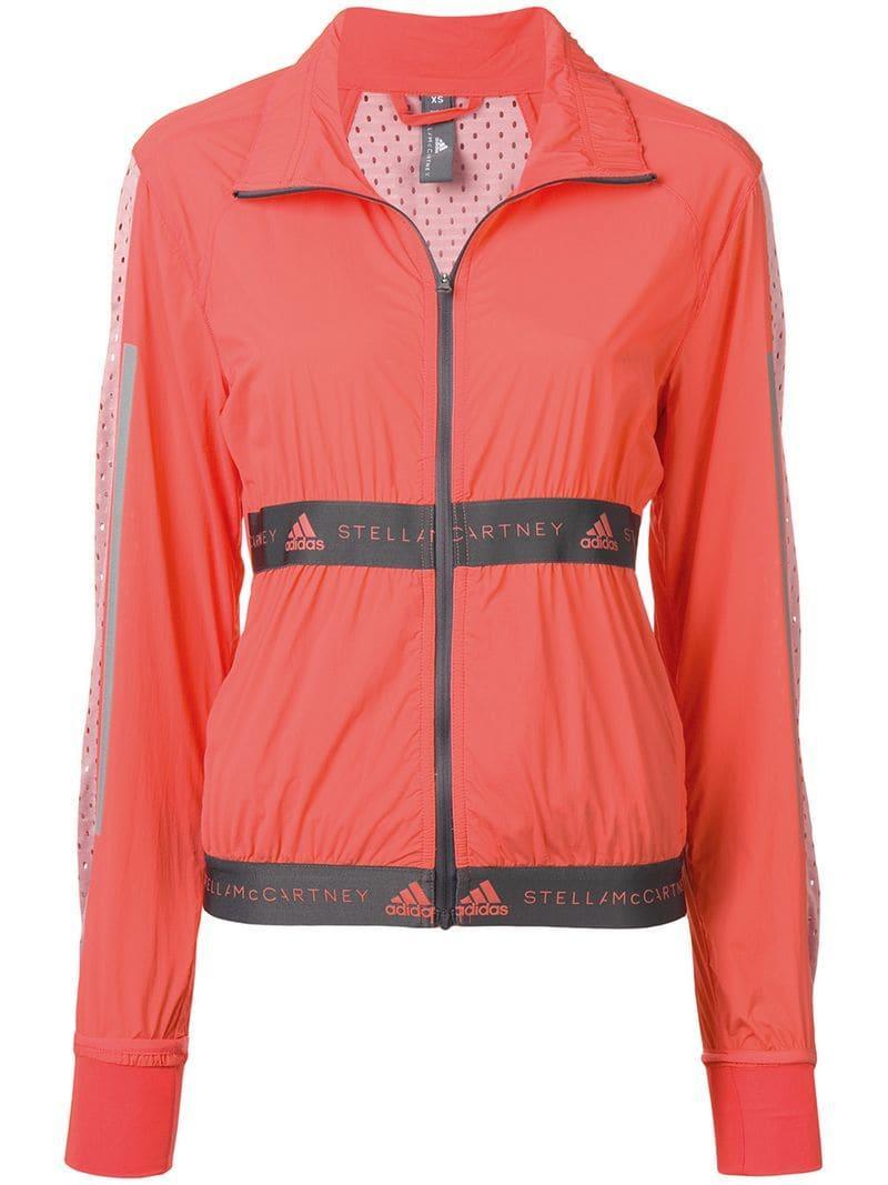 size 40 6f139 18603 adidas By Stella McCartney. Women s Orange Run Lightweight Jacket
