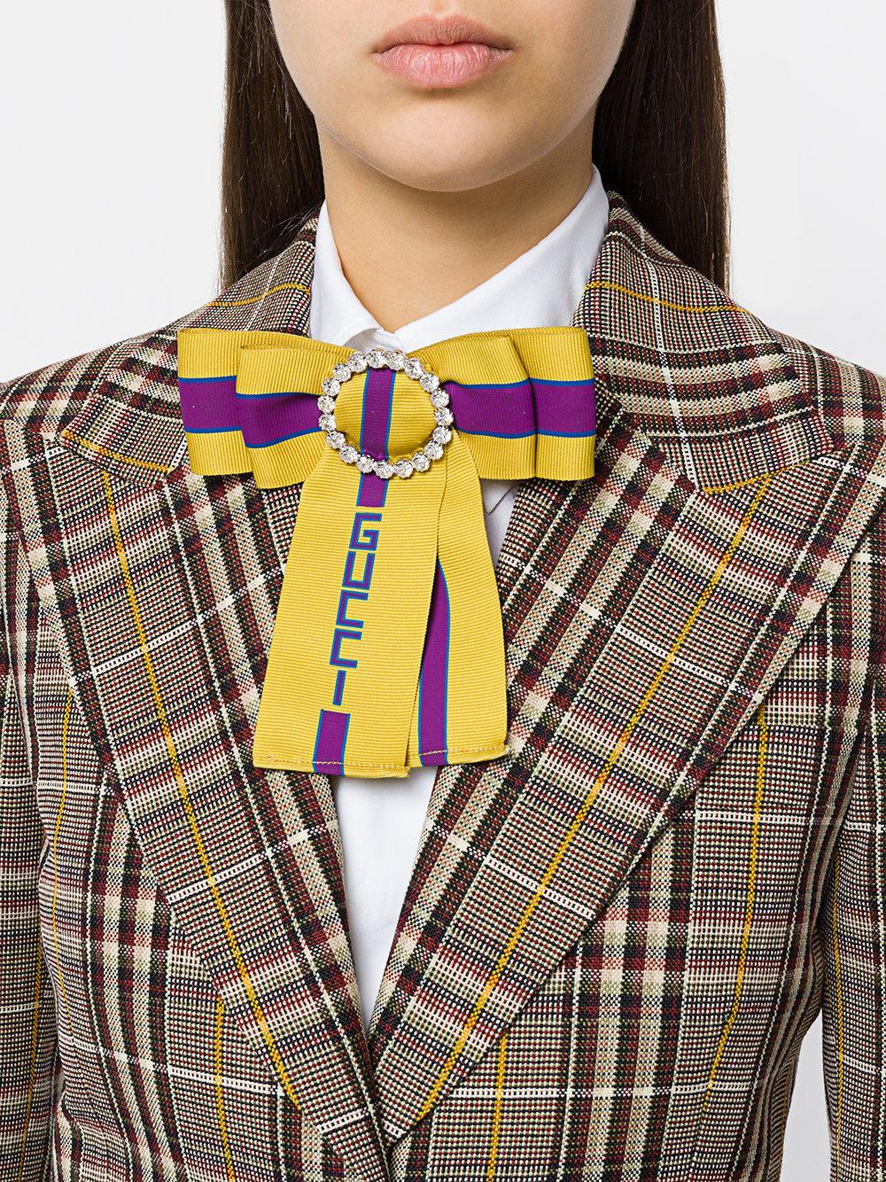 57efa7155aa Lyst - Gucci Web Logo Bow Brooch