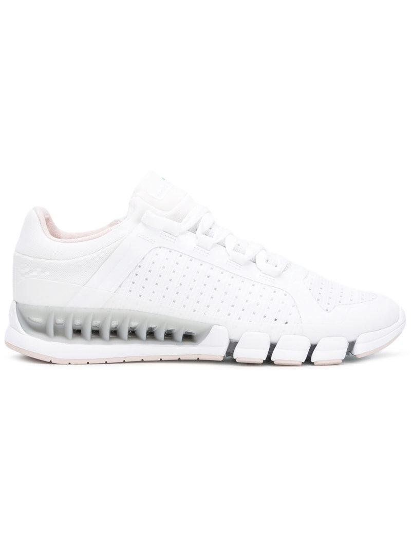 39b242fd27de adidas By Stella McCartney Climacool Revolution Sneakers in White - Lyst